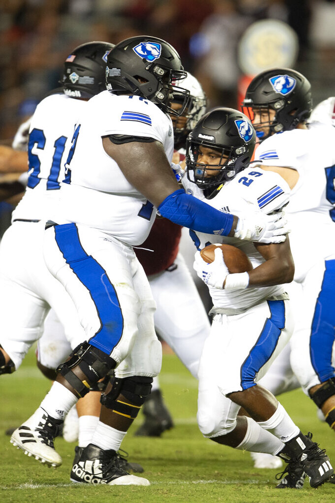 Eastern Illinois running back Kendi Young (29) runs into Eastern Illinois offensive lineman Elkhanan Tanelus (72) during the second half of an NCAA college football game against South Carolina, Saturday, Sept. 4, 2021, in Columbia, S.C. (AP Photo/Hakim Wright Sr.)