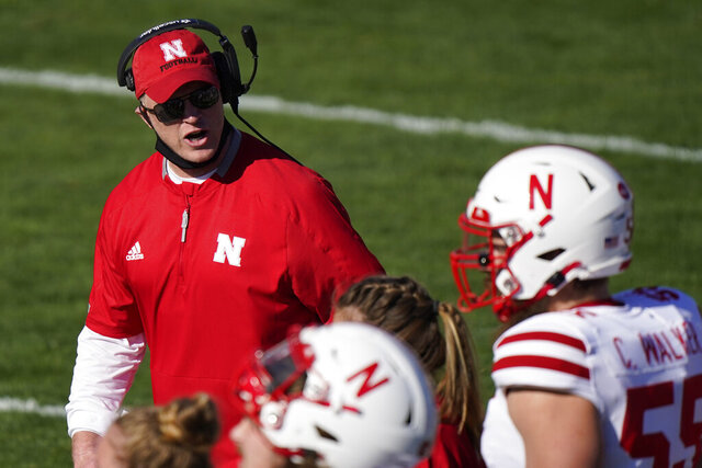 Nebraska head coach Scott Frost talks to his team during the first half of an NCAA college football game against Northwestern in Evanston, Ill., Saturday, Nov. 7, 2020. Northwestern won 21-13. (AP Photo/Nam Y. Huh)