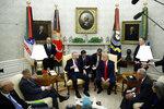 President Donald Trump and Turkish President Recep Tayyip Erdogan meet in the Oval Office with Republican senators at the White House Wednesday, Nov. 13, 2019, in Washington. (AP Photo/Patrick Semansky)