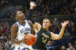 Villanova forward Dhamir Cosby-Roundtree (21) drives to the basket past Army forward Matt Wilson (14) during the first half of an NCAA college basketball game Tuesday, Nov. 5, 2019, in Villanova, Pa. (AP Photo/Laurence Kesterson)
