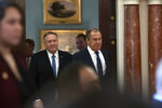 Secretary of State Mike Pompeo, left, follows Russian Foreign Minister Sergey Lavrov to a media availability, after their meeting at the State Department, Tuesday, Dec. 10, 2019, in Washington. (AP Photo/Alex Brandon)