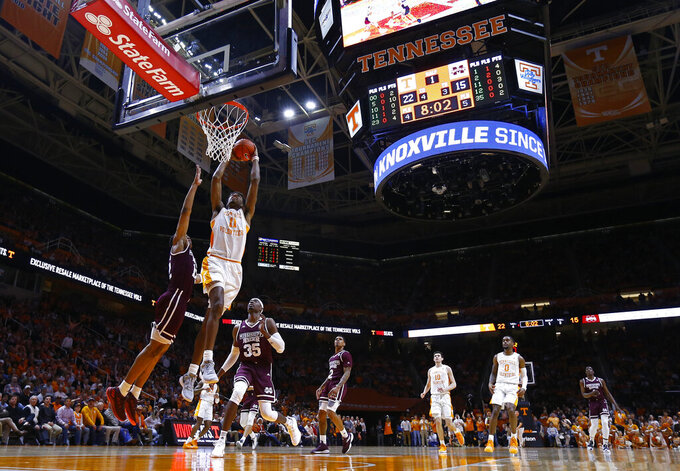 Tennessee forward Kyle Alexander (11) dunks against Mississippi State guard Robert Woodard (12) during the first half of an NCAA college basketball game Tuesday, March 5, 2019, in Knoxville, Tenn. (AP Photo/Wade Payne)