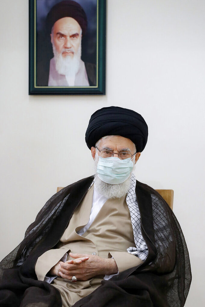 In this photo released by an official website of the office of the Iranian supreme leader, Supreme Leader Ayatollah Ali Khamenei speaks in a meeting in Tehran, Iran, Friday, July 23, 2021. Ayatollah Khamenei on Friday said he understands protesters' anger over a drought in the country's southwest, as a fourth death related to ongoing demonstrations there was reported. A portrait of the late revolutionary founder Ayatollah Khomeini hangs on the wall. (Office of the Iranian Supreme Leader via AP)