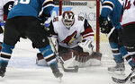 Arizona Coyotes goaltender Scott Wedgewood (31) blocks a shot at goal by the San Jose Sharks during the first period of an NHL hockey game Saturday, Jan. 13, 2018, in San Jose, Calif. (AP Photo/Tony Avelar)