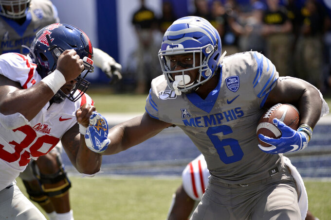 Memphis running back Patrick Taylor Jr. (6) carries the ball against Mississippi defensive back Kweisi Fountain (39) in the first half of an NCAA college football game Saturday, Aug. 31, 2019, in Memphis, Tenn. (AP Photo/Brandon Dill)