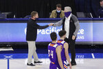 Gonzaga coach Mark Few, left, and Northwestern State coach Mike McConathy greet each other after an NCAA college basketball game in Spokane, Wash., Tuesday, Dec. 22, 2020. Gonzaga won 95-78. (AP Photo/Young Kwak)