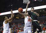 Marshall's Jannson Williams (3) tries to sneak a shot past Virginia's forward Jay Huff (30) in the first half of an NCAA college basketball game on Monday, Dec. 31, 2018, in Charlottesville, Va. (AP Photo/Zack Wajsgras)