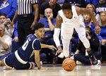 Duke's RJ Barrett, right, chases the ball as Georgia Tech's Michael Devoe (0) looks on during the second half of an NCAA college basketball game in Durham, N.C., Saturday, Jan. 26, 2019. Duke won 66-53. (AP Photo/Gerry Broome)