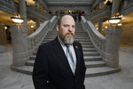 In this Friday, Feb. 7, 2020, photo, Utah Republican Sen. Daniel Thatcher poses for a portrait at the Utah State Capitol in Salt Lake City. Polygamists may not face jail time under new Utah bill. Utah could ease its law against polygamy under a new proposal at the state Legislature.
