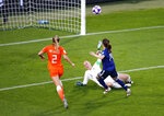 Japan's Yui Hasegawa, right, kicks the ball past Netherlands goalkeeper Sari Van Veenendaal to score her team's first goal during the Women's World Cup round of 16 soccer match between the Netherlands and Japan at Roazhon Park, in Rennes, France, Tuesday, June 25, 2019. (AP Photo/Francois Mori)