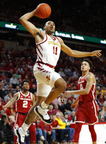 Iowa State guard Talen Horton-Tucker (11) drives to the basket past Oklahoma's Aaron Calixte (2) and Jamuni McNeace, right, during the second half of an NCAA college basketball game, Monday, Feb. 25, 2019, in Ames, Iowa. (AP Photo/Charlie Neibergall)