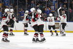Arizona Coyotes' Conor Garland (83) is congratulated by Jordan Oesterle (82) after scoring the game-winning goal during a shootout of an NHL hockey game against the St. Louis Blues Tuesday, Nov. 12, 2019, in St. Louis. The Coyotes won 3-2. (AP Photo/Jeff Roberson)