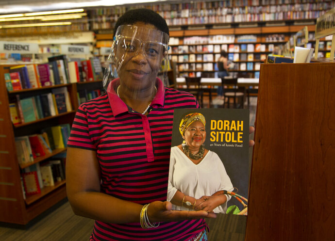 Book store worker, Dikeledi Nhlapo, holds a copy of Dorah Sitole's