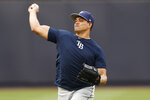 Tampa Bay Rays' starting pitcher Yonny Chirinos throws on the field after a scheduled baseball game between the New York Yankees and the Tampa Bay Rays was postponed due to the possibility of severe thunderstorms, Wednesday, July 17, 2019, in New York. (AP Photo/Kathy Willens)