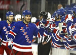 New York Rangers' Brendan Smith (42) celebrates his goal with teammates on the bench in the first period against the Philadelphia Flyers during an NHL hockey game Thursday, April 22, 2021, in New York. (Elsa/Pool Photo via AP)