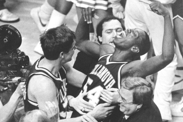 FILE - In this April 1, 1985, file photo, Villanova's Ed Pinckney (54) yells out as he is surrounded by teammates after defeating Georgetown 66-64 in the NCAA college basketball Final Four championship game, in Lexington, Ky. (AP Photo/Gary Landers, File)