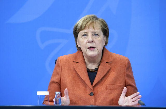 After the switching conference between her and the prime ministers of the federal states, Chancellor Angela Merkel (CDU) comments on the further procedure in the Corona crisis at a press conference in the Federal Chancellery, on Sunday, Dec.13, 2012. (Bernd von Jutrczenka/dpa via AP)