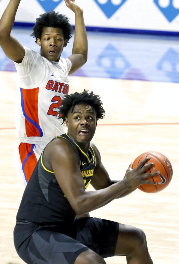 Missouri forward Kobe Brown (24) looks for a shot during an NCAA college basketball game against Florida, Wednesday, March 3, 2021 in Gainesville, Fla. (Brad McClenny/The Gainesville Sun via AP)