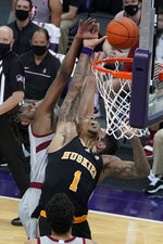 Washington forward Nate Roberts (1) shoots as Stanford guard Daejon Davis, left, defends during the first half of an NCAA college basketball game Thursday, Feb. 18, 2021, in Seattle. (AP Photo/Ted S. Warren)