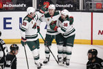 FILE - Minnesota Wild's Kirill Kaprizov, center, of Russia, celebrates his goal with Ryan Suter, left, and Mats Zuccarello, of Norway, during the first period of an NHL hockey game against the Los Angeles Kings in Los Angeles, in this Friday, April 23, 2021, file photo. One of five Wild players to skate in all 56 games, the 24-year-old Kaprizov finished the regular season with 27 goals and 51 points to lead all NHL rookies in both categories. (AP Photo/Jae C. Hong, File)