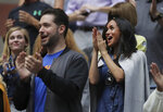 Meghan, Duchess of Sussex, right, and Alexis Ohanian, left, applaud as players are introduced before the start of the women's singles final of the U.S. Open tennis championships between Serena Williams, of the United States, and Bianca Andreescu, of Canada, Saturday, Sept. 7, 2019, in New York. (AP Photo/Charles Krupa)