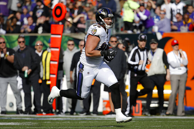 Baltimore Ravens tight end Nick Boyle (86) runs the ball during the first half of NFL football game against the Cincinnati Bengals, Sunday, Nov. 10, 2019, in Cincinnati. (AP Photo/Frank Victores)