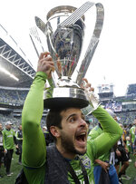 Seattle Sounders' Victor Rodriguez celebrates, Sunday, Nov. 10, 2019, after the team beat the Toronto FC in the MLS Cup championship soccer match in Seattle. The Sounders won 3-1. (AP Photo/Elaine Thompson)