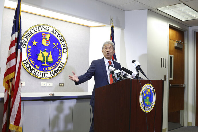 Honolulu acting prosecutor Dwight Nadamoto speaks at a news conference in Honolulu, Wednesday, Nov. 20, 2019. Nadamoto says he's been subpoenaed to testify before a federal grand jury. Adamoto stepped in as Honolulu's top prosecutor after Keith Kaneshiro received notice from the FBI that he's a target in an investigation. Kaneshiro denies any wrongdoing. (AP Photo/Jennifer Sinco Kelleher)