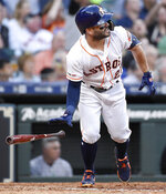 Houston Astros' Jose Altuve watches his solo home run off New York Yankees starting pitcher Masahiro Tanaka during the fourth inning of a baseball game, Monday, April 8, 2019, in Houston. (AP Photo/Eric Christian Smith)