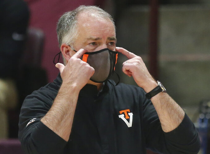 FILE - In this Jan. 10, 2021, file photo, Virginia Tech coach Mike Young watches during the first half of the team's NCAA college basketball game against Notre Dame in Blacksburg, Va. Young is entering his third season as coach of the team. (Matt Gentry/The Roanoke Times via AP, Pool, File)