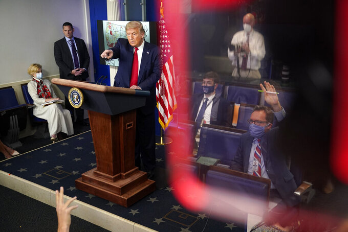 President Donald Trump calls for questions during a news conference at the White House, Thursday, July 23, 2020, in Washington. (AP Photo/Evan Vucci)