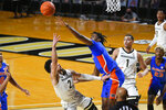 Florida forward Omar Payne blocks a shot by Vanderbilt guard Scotty Pippen Jr. (2) during the first half of an NCAA college basketball game Wednesday, Dec. 30, 2020, in Nashville, Tenn. (AP Photo/John Amis)