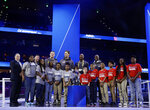 Members of the New England Patriots and Los Angeles Rams pose for a picture during Opening Night for the NFL Super Bowl 53 football game Monday, Jan. 28, 2019, in Atlanta. (AP Photo/Matt Rourke)