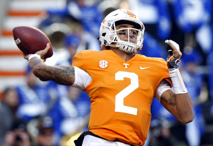 Tennessee quarterback Jarrett Guarantano (2) throws a pass in the first half of an NCAA college football game against Kentucky Saturday, Nov. 10, 2018, in Knoxville, Tenn. (AP Photo/Wade Payne)