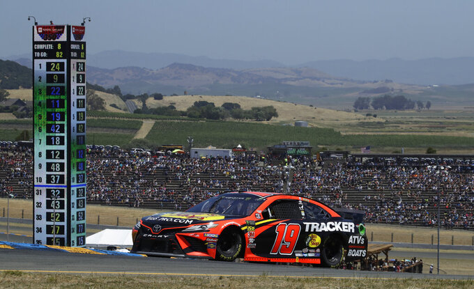 Martin Truex Jr. (19) competes during a NASCAR Sprint Cup Series auto race Sunday, June 23, 2019, in Sonoma, Calif. (AP Photo/Ben Margot)