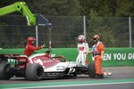 A crane takes the car of Alfa Romeo driver Kimi Raikkonen of Finland after went off the track during the first free practice at the Monza racetrack, in Monza, Italy, Friday, Sept. 6, 2019. The Formula one race will be held on Sunday. (AP Photo/Luca Bruno)