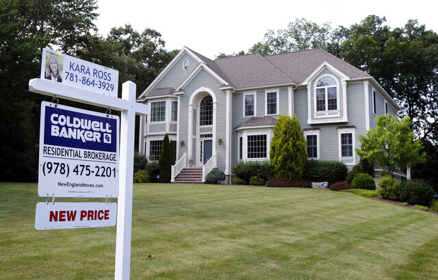 FILE - This July 10, 2017, file photo shows a house for sale, in North Andover, Mass. Nearly a third of Americans who've never previously bought a home say they plan to in the next five years, according to a survey commissioned by NerdWallet and conducted online by The Harris Poll among 2,007 U.S. adults in January 2020. (AP Photo/Elise Amendola, File)