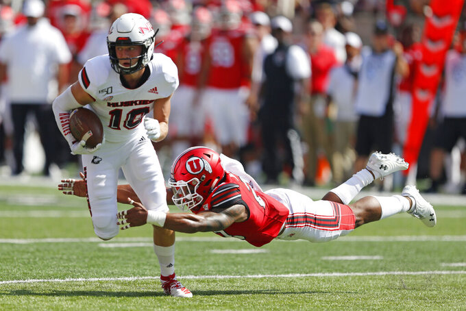 Utah defensive back Julian Blackmon (23) tackles Northern Illinois wide receiver Fabian McCray (10) in the first half of an NCAA college football game Saturday, Sept. 9, 2019, Salt Lake City. (AP Photo/Rick Bowmer)