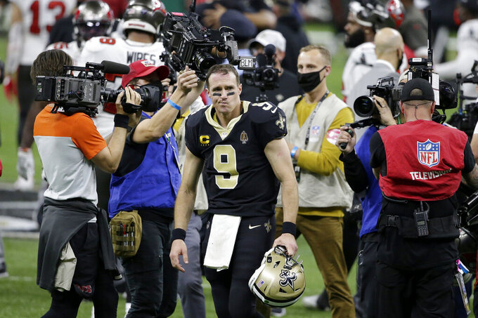 New Orleans Saints quarterback Drew Brees (9) leaves the field after an NFL divisional round playoff football game against the Tampa Bay Buccaneers, Sunday, Jan. 17, 2021, in New Orleans. The Buccaneers won 30-20. (AP Photo/Butch Dill)
