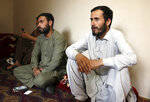 Romal Ahmadi, right, speaks during an interview with The associated Press during a U.S. drone strike in Kabul, Afghanistan, Thursday, Sept. 2, 2021. Ahmadi says Sunday's U.S. drone strike killed 10 members of his family, six of them children. Senior U.S. military officials said the drone strike hit an Islamic State target and disrupted the extremist' ability to further disrupt the final phase of the U.S. withdrawal from Afghanistan. (AP Photo/Khwaja Tawfiq Sediqi)