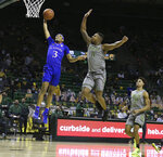 Baylor guard Mark Vital pressures the shot of Kansas guard Dajuan Harris, left, in the first half of an NCAA college basketball game, Monday, Jan. 18, 2021, in Waco, Texas. (Rod Aydelotte/Waco Tribune-Herald via AP)