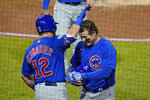 Chicago Cubs' Anthony Rizzo, right, celebrates with Kyle Schwarber (12) as he returns to the dugout after hitting a two-run home run off Pittsburgh Pirates relief pitcher Sam Howard during the eighth inning of a baseball game in Pittsburgh, Tuesday, Sept. 22, 2020. (AP Photo/Gene J. Puskar)