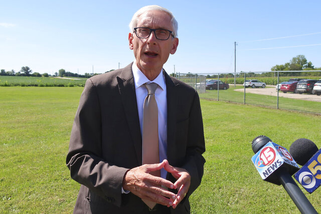FILE - In this Aug. 29, 2019, file photo, Gov. Tony Evers speaks to the media in Beaver Dam, Wis. Evers is laying out his policy agenda and goals for the year in his second State of the State speech to the Legislature on Wednesday, Jan. 22, 2020. (AP Photo/Scott Bauer, File)