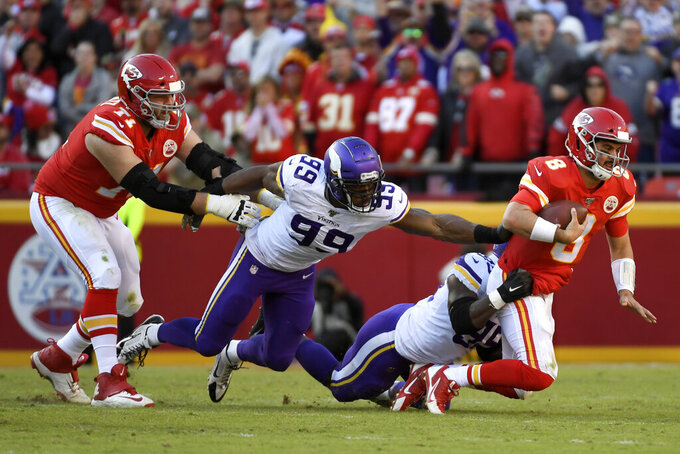 Minnesota Vikings defensive end Ifeadi Odenigbo (95) and defensive end Danielle Hunter (99) sack Kansas City Chiefs quarterback Matt Moore (8) during the second half of an NFL football game in Kansas City, Mo., Sunday, Nov. 3, 2019. (AP Photo/Reed Hoffmann)