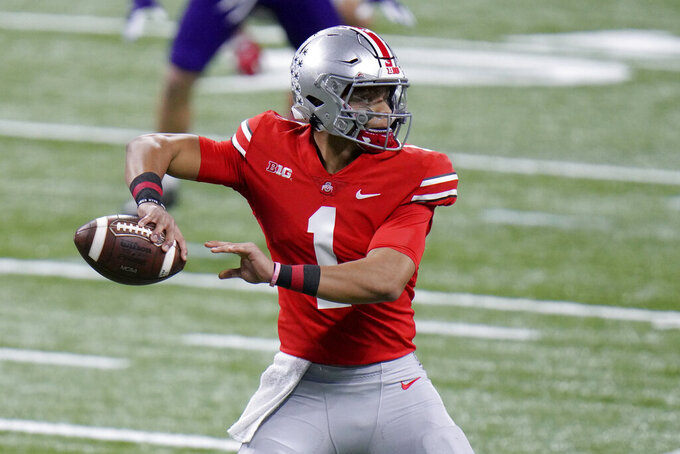 FILE - In this Saturday, Dec. 19, 2020, file photo, Ohio State quarterback Justin Fields throws during the first half of the Big Ten championship NCAA college football game against Northwestern, in Indianapolis. (AP Photo/AJ Mast, File)