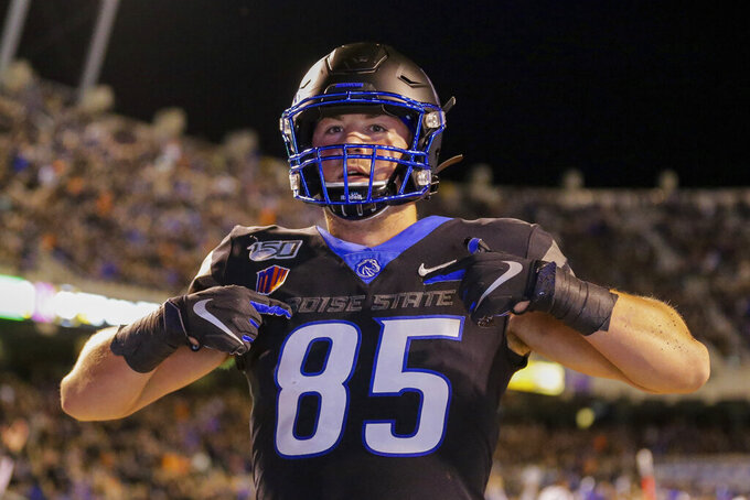 Boise State tight end John Bates celebrates after scoring a touchdown during the second half of the team's NCAA college football game against Air Force, Friday, Sept. 20, 2019, in Boise, Idaho. (AP Photo/Steve Conner)