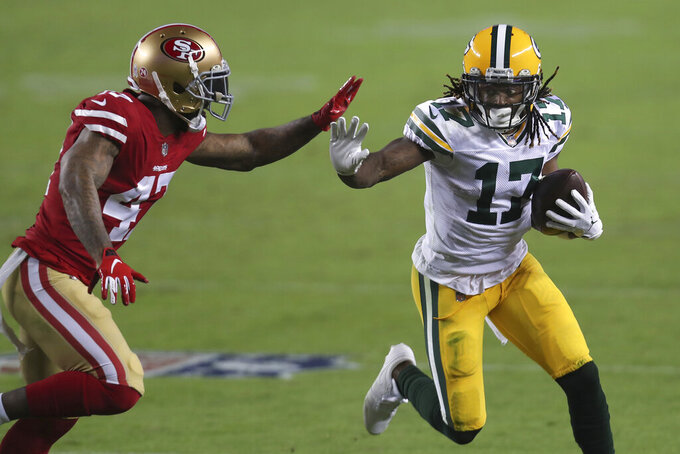 Green Bay Packers wide receiver Davante Adams (17) runs against San Francisco 49ers cornerback Jamar Taylor during the second half of an NFL football game in Santa Clara, Calif., Thursday, Nov. 5, 2020. (AP Photo/Jed Jacobsohn)