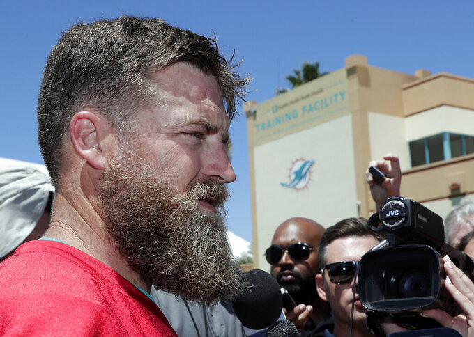 Miami Dolphins quarterback Ryan Fitzpatrick talks to the news media during voluntary minicamp at the Miami Dolphins NFL football training facility, Tuesday, April 16, 2019, in Davie, Fla. (AP Photo/Lynne Sladky)