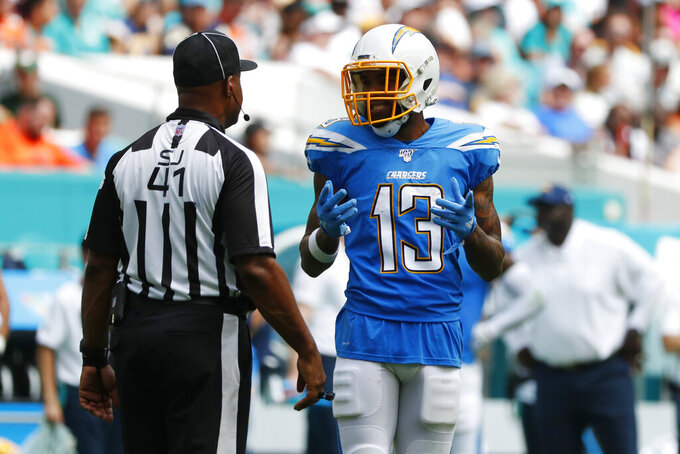 Los Angeles Chargers wide receiver Keenan Allen (13) argues a call with side judge Anthony Jeffries, during the first half at an NFL football game against the Miami Dolphins, Sunday, Sept. 29, 2019, in Miami Gardens, Fla. Allen's touchdown was nullified due to offensive pass interference, (AP Photo/Wilfredo Lee)