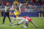 FILE - In this Nov. 16, 2019, file photo, LSU quarterback Joe Burrow (9) avoids Mississippi linebacker Jacquez Jones (10) during the first half of an NCAA college football game, in Oxford, Miss. LSU quarterback Joe Burrow is The Associated Press college football player of the year in a landslide vote.  Burrow, who has led the top-ranked Tigers to an unbeaten season and their first College Football Playoff appearance, received 50 of 53 first-place votes from AP Top 25 poll voters and a total of 156 points. (AP Photo/Thomas Graning, File)